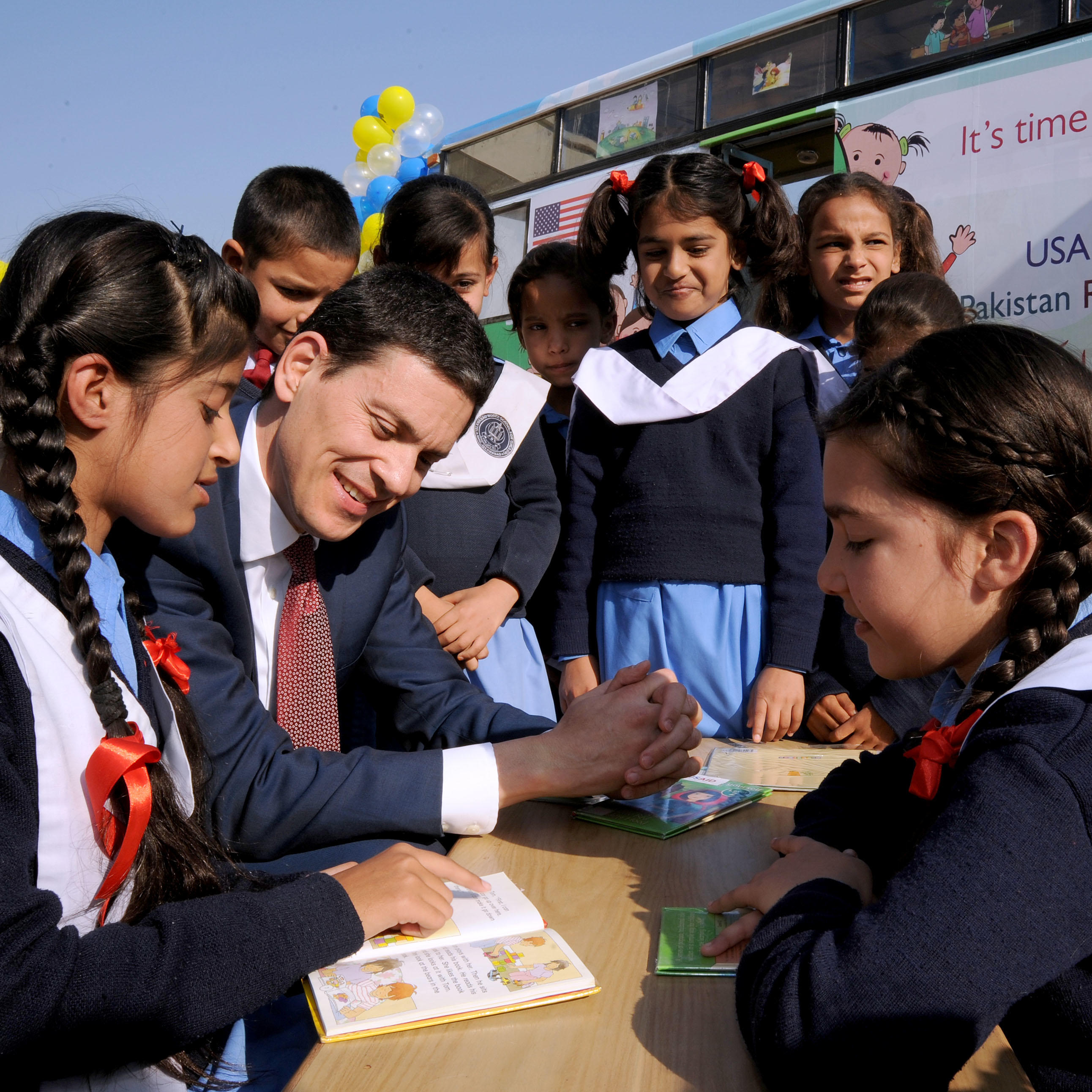 Reading session with students from the Islamabad Model School during the inauguration of the mobile library program.