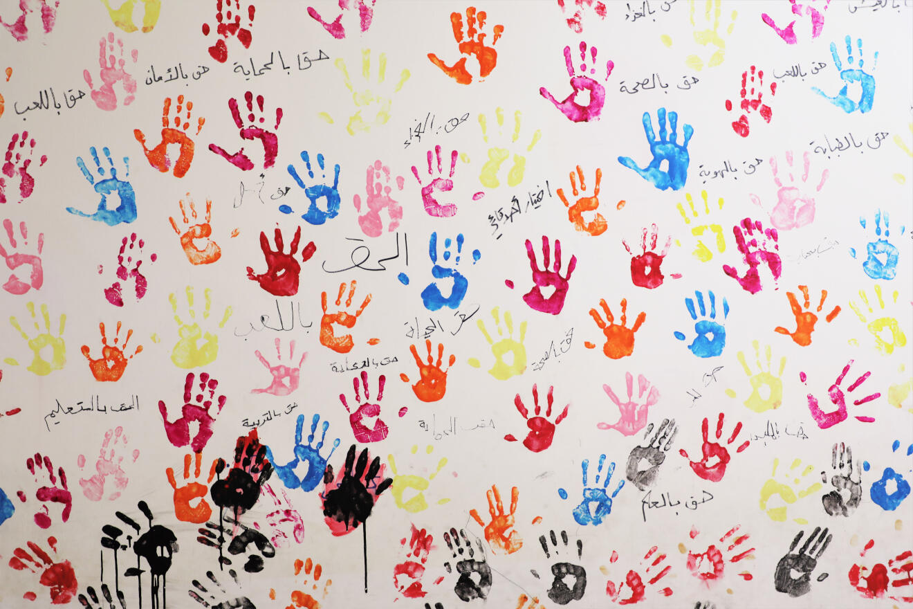 Children's handprints on the walls of the IRC centre in North Lebanon